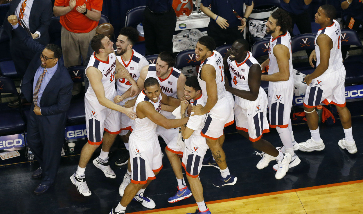 Mar 5, 2016; Charlottesville, VA, USA; Virginia Cavaliers players celebrate on the bench after a three point feel goal by Cavaliers forward Caid Kirven (not pictured) in the final minute against the Louisville Cardinals at John Paul Jones Arena. The Cavaliers won 68-46. Mandatory Credit: Geoff Burke-USA TODAY Sports